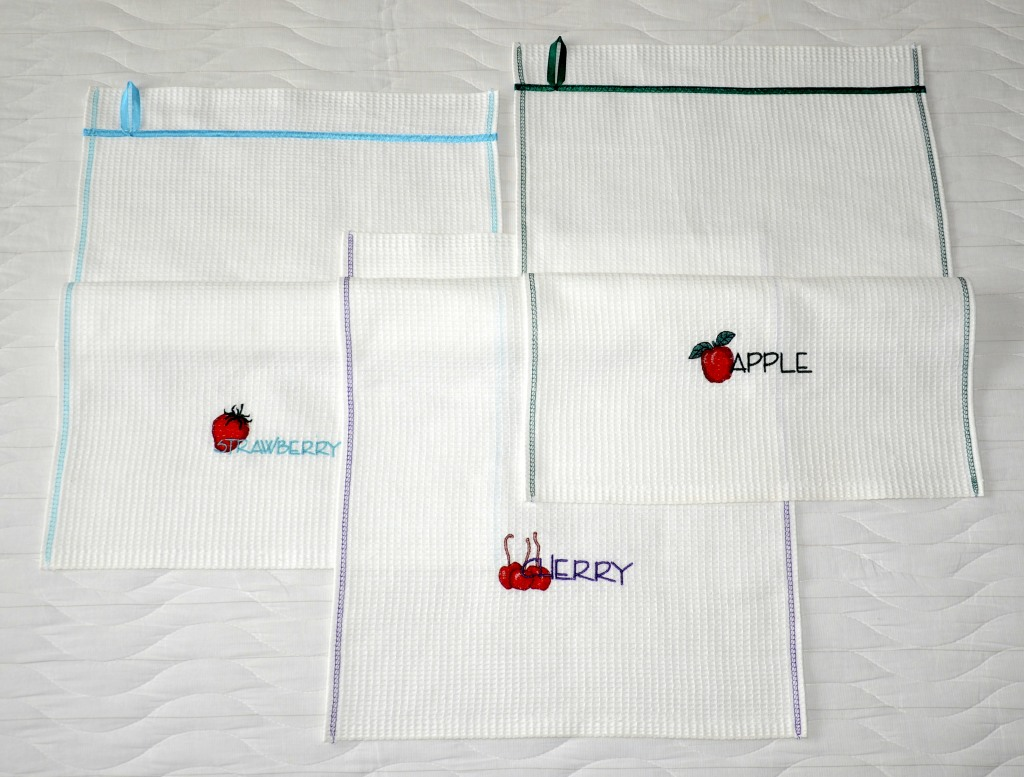 Вышитые кухонные полотенчики. Красные фрукты